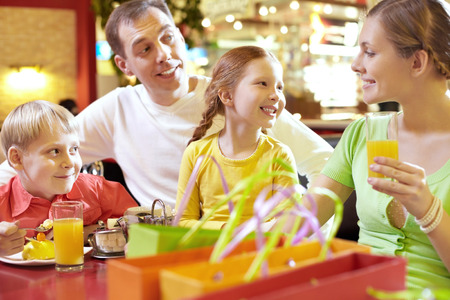 food court: A family of four sitting together in cafe