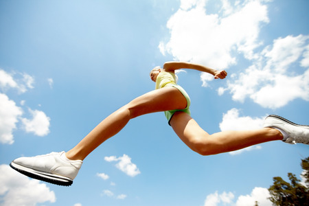 angle: Low angle view of a jumping girl
