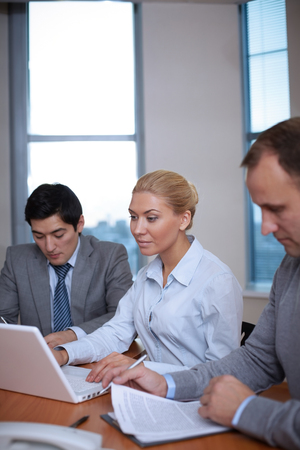 workday: End of workday. Three business people working in office Stock Photo