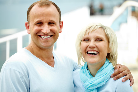 long lasting: Portrait of laughing couple looking at camera
