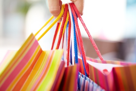 several: Several shopping bags in female hand Stock Photo