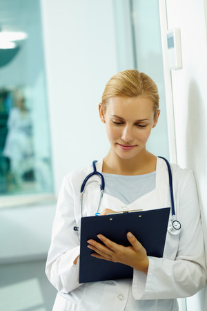 general practitioner: Portrait of a general practitioner making notes Stock Photo