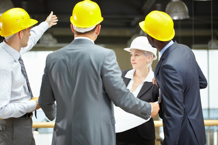 inspector: Construction executive showing the site to inspector
