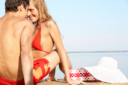 A young couple flirting on beach photo