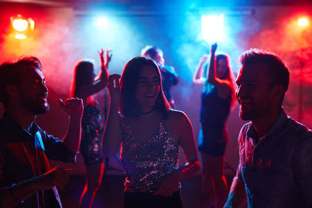 clubber: Dancers having talk in night club during disco party