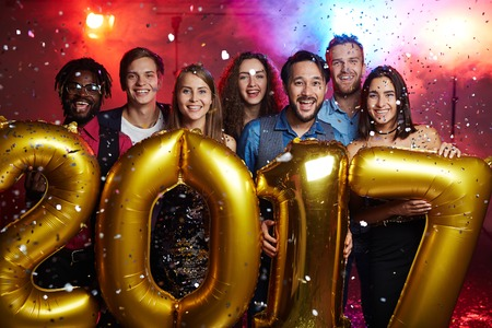 Friends holding balloons in form of 2017 Stock Photo
