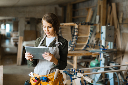 woodworker: Young woodworker or maintenance manager making online selection of materials for work
