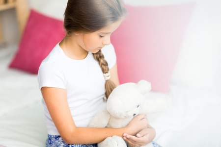 Girl with teddybear being sad or offended
