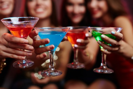 Female hands with cocktails during toast Stock Photo