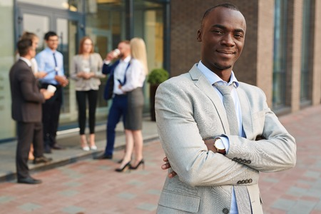 Modern employer on background of talking managers