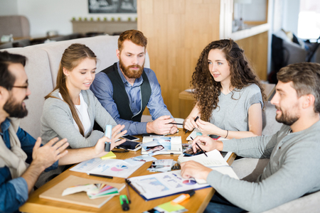 stock photography: Group of designers or managers discussing new tendencies on stock photography market
