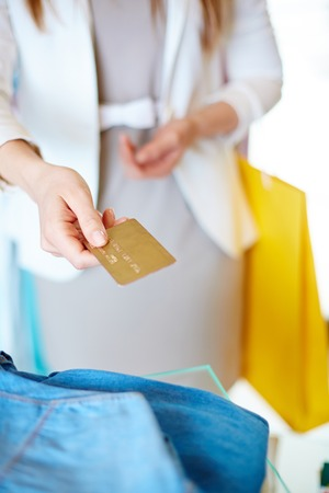 shopaholism: Modern shopper paying by credit card Stock Photo