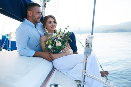 cruise travel: Just married couple traveling by sea on yacht Stock Photo