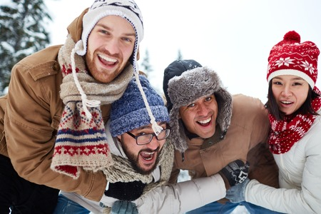 ecstatic: Ecstatic young people enjoying hangout on winter day