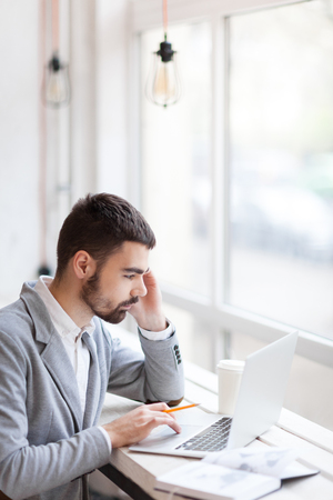 technology career: Businessman thinking of new ideas at coffee break Stock Photo