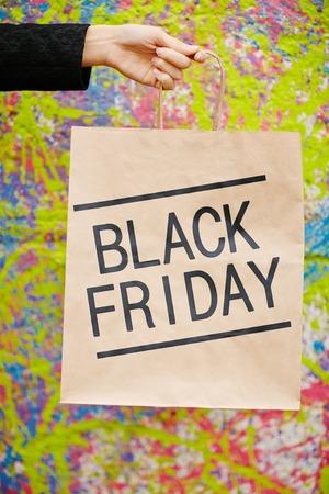 paperbag: Black Friday paperbag in hand of shopper