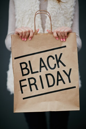 paperbag: Black Friday purchase in paperbag held by consumer