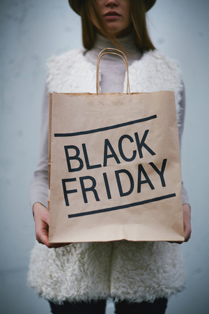 shoppingbag: Young buyer holding Black Friday bag