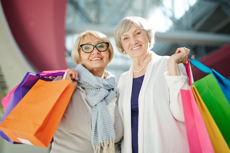paperbags: Female pensioners with paperbags visiting shopping mall Stock Photo
