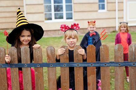 Little girls asking for Halloween treats Stock Photo