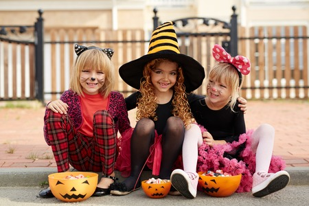 Group of happy Halloween girls with treats Stock Photo