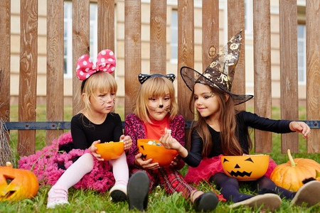 little one: Little witch sharing tasty sweet with one of her friends