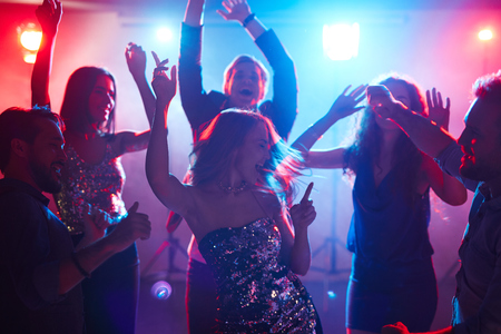 ecstatic: Ecstatic friends enjoying party with dancing Stock Photo