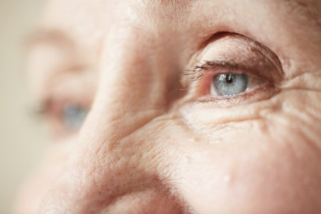 eyelid: Eyes and upper part of nose of elderly woman Stock Photo