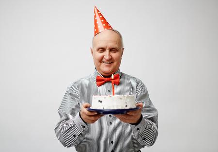 party pastries: Happy elegant man holding birthday dessert Stock Photo