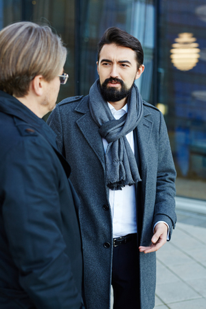 welldressed: Well-dressed entrepreneur talking to colleague Stock Photo