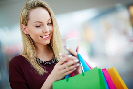 paperbags: Shopper with paperbags reading promo sms