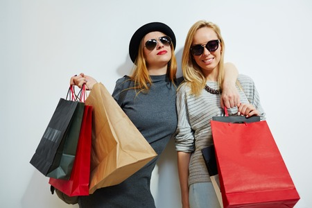 Female consumers with paperbags after shopping Stock Photo