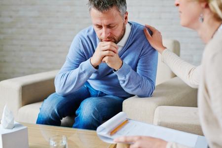 Man in deep upset visiting psychologist