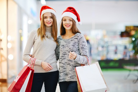 shoppingbag: Two shoppers bought Christmas presents in shopping-center