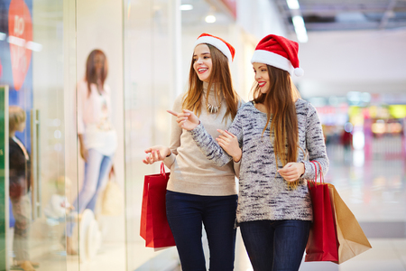 Shopping girls looking for xmas gifts in the mall