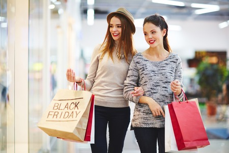 Modern customers shopping on Black Friday Фото со стока