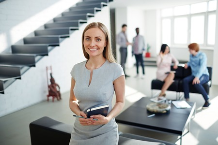 happy work: Qualified specialist looking at camera in working environment Stock Photo
