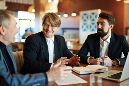 tendencies: Three businessmen sharing ideas about financial tendencies