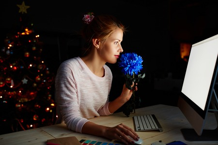 christmas spending: Young designer spending Christmas night in office
