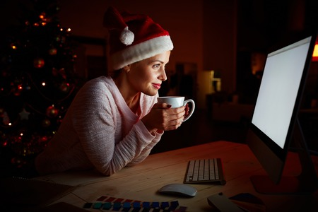 christmas movies: Girl spending xmas night in front of computer