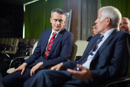 Two politicians discussing speech of the latest spokesperson photo