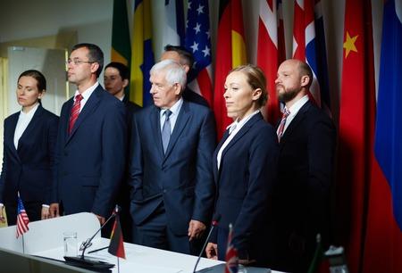 delegates: Political delegates standing by tribune before conference