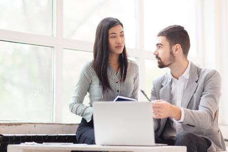 tendencies: Young banker explaining his co-worker new tendencies on stock market