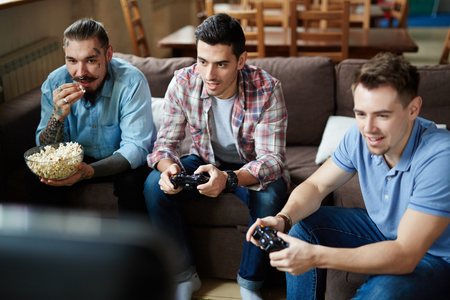 videogame: Video-game lovers playing at leisure