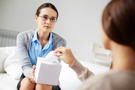 Psychologist offering her patient paper wipes after session Stock Photo