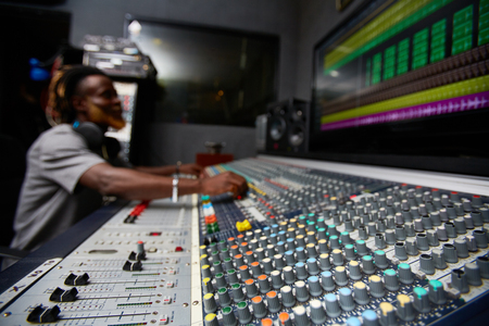 soundboard: Soundboard with volume control and mixing switches with deejay on background
