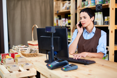 selfemployed: Self-employed woman working in private supermarket