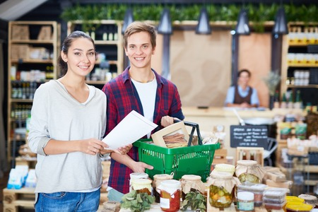 Young couple choosing products in private supermarket