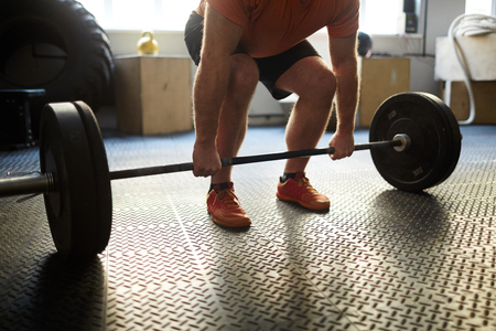 heavy weight: Bodybuilder lifting heavy weight in gym Stock Photo