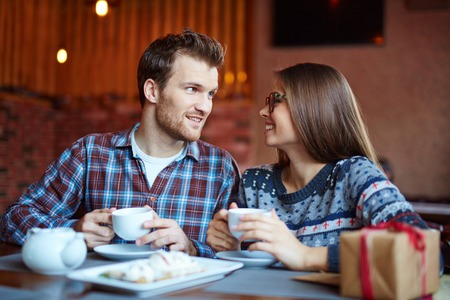 amorous: Amorous man and woman having coffee and talking in cafe